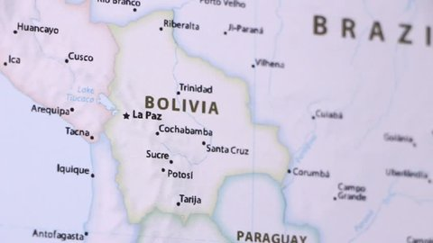 Bolivia on a political map of the world. Video defocuses showing and hiding the map.