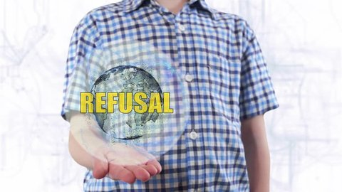 Young man shows a hologram of the planet Earth and text Refusal. Boy with future technology 3d projection on a modern white digital background