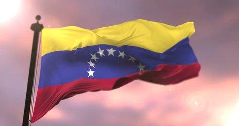 Venezuela flag waving at wind in slow at sunset, loop