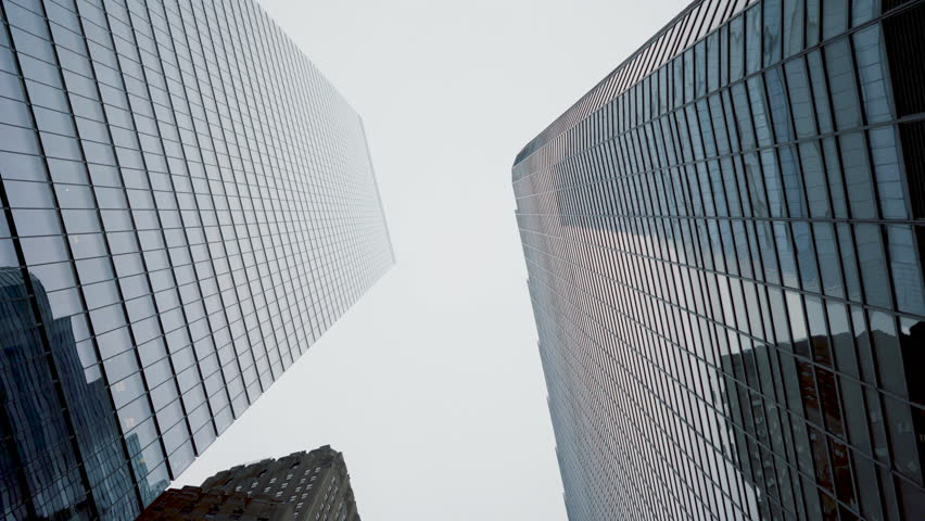 Low Angle Gliding Shot of Skyscrapers in the New York City. Financial District. Vertical POV Dolly Style Shot. Shot on RED Epic 4K UHD Camera.