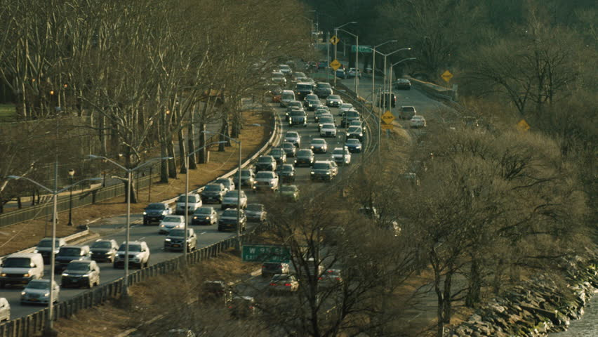Aerial shot of traffic in large city. Flying over highway in New York. Shot with a RED camera. 4k footage.