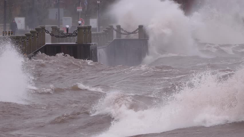 Huge powerful waves breaking at seawall in major severe storm in hurricane force winds | Shutterstock HD Video #1011370412