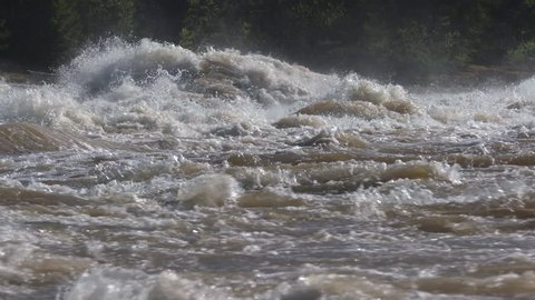 very strong raging river, slow motion