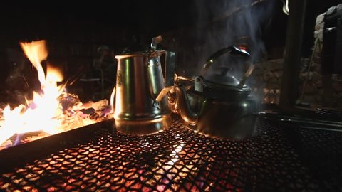 Metal Kettles Boil Over A Campfire