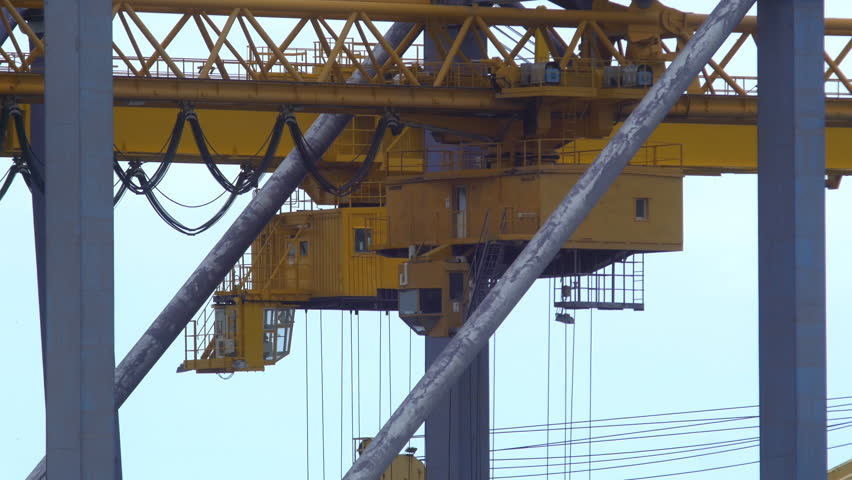 Detail of cranes moving at a container port in Palermo | Shutterstock HD Video #1011424562