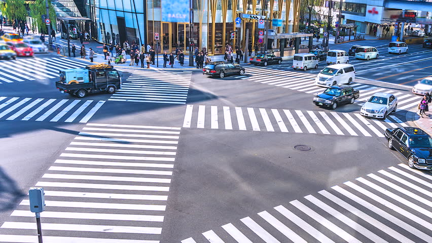 4K,Time lapse traffic and crowd people at ginza district intersection in Tokyo of Japan | Shutterstock HD Video #1011427622