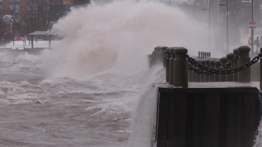 Intense waves rolling in and breaking during storm with hurricane force winds    Shutterstock HD Video #1011451232