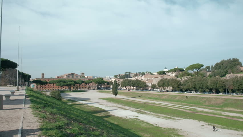 High angle panning right of Circus Maximus grounds with Palentine Hills ruins background in ancient Rome, Italy. 4K UHD at 29.97fps | Shutterstock HD Video #1011502322