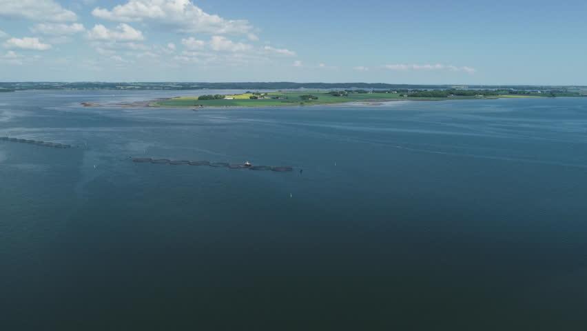 Drone flight over fish farm nets in Jutland, Denmark | Shutterstock HD Video #1011502352
