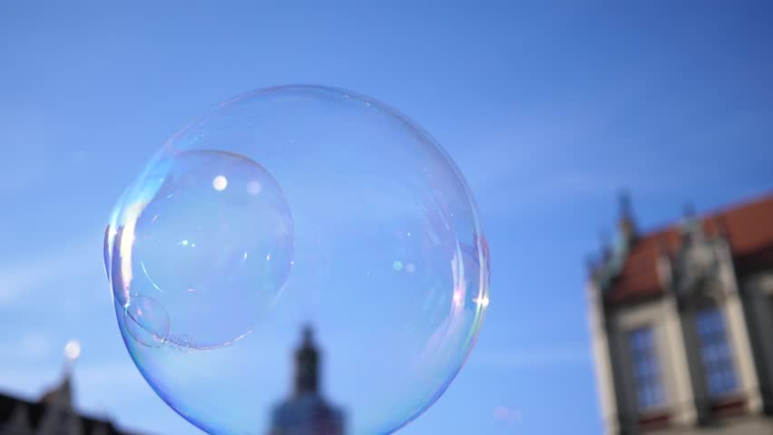 Slow motion fly of a big soap bubble in a city center public place in Wroclaw Poland   Shutterstock HD Video #1011507932