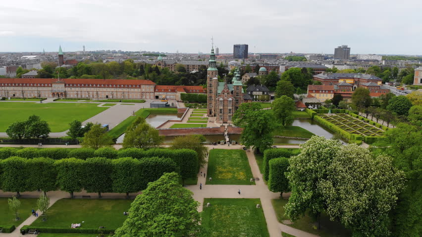 Aerial view of Rosenborg Castle (renaissance style palace) situated in The King's Garden (Kongens Have) - central Copenhagen, capital city of Denmark from above | Shutterstock HD Video #1011516242