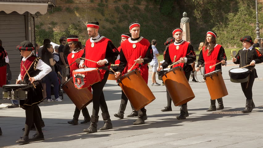 LUGO (RA), ITALY - MAY 20, 2018: drummers walk in medieval parade under castle