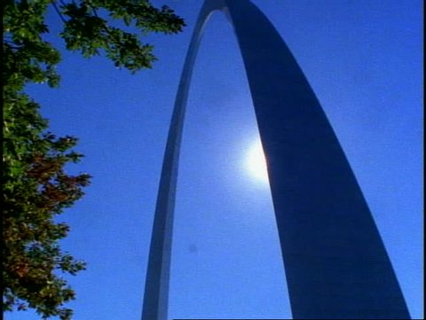 ST. LOUIS, 1999, St. Louis Arch, wide shot arch only, no people, silhouette, tilt up, dramatic