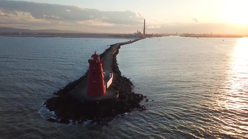 Aerial footage of Poolbeg Lighthouse in Dublin, Ireland  | Shutterstock HD Video #1011555872
