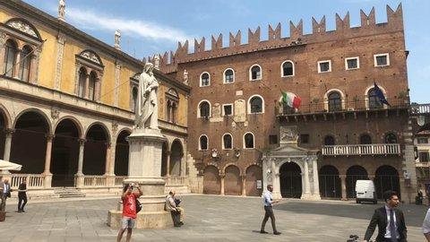 Verona, Italy - 8 May,2018: Statue of Dante Alighieri in Piazza dei Signori in Verona, Italy