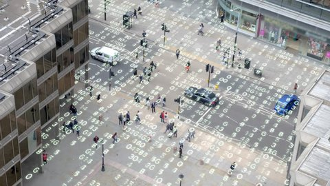 Living in an urban matrix data world.  High angle shot of a London street overlaid with matrix style changing numbers.