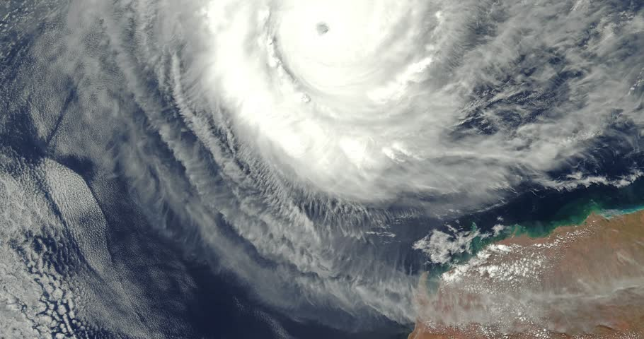 Very high-altitude overflight aerial of 2018 Category 5 Cyclone Marcus, off Australia. Clip loops and is reversible. Elements of this image furnished by NASA