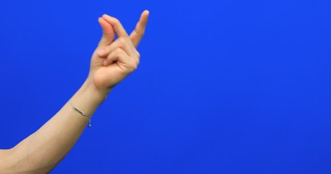 Hand with snapping fingers on blue screen background