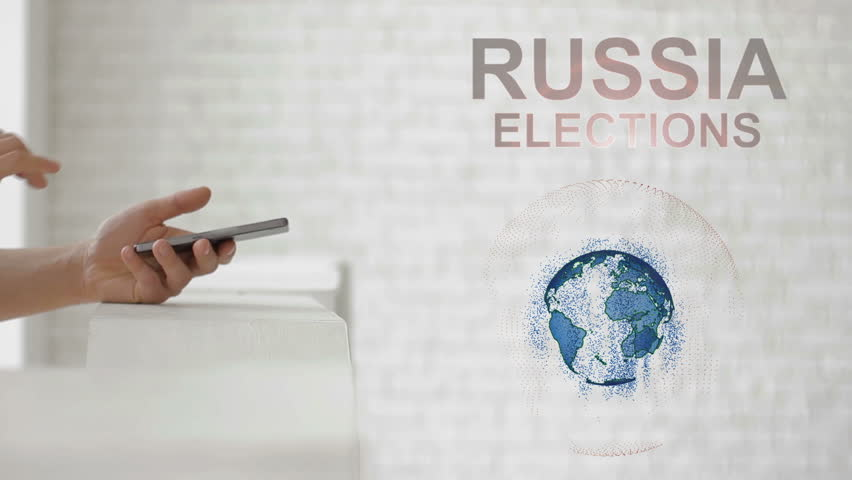 Hands launch the Earth's hologram and Russia elections text. Man with future technology phone is showing a 3d projection on a modern white background