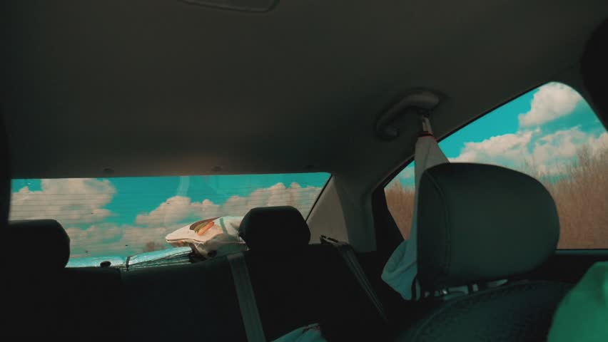 Car rides along the road view from inside the cabin slow motion video lifestyle   Shutterstock HD Video #1011694322