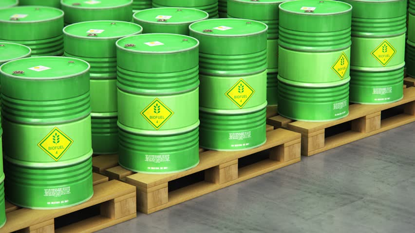 3D render illustration of the group of green stacked metal biofuel drums or biodiesel barrels in the industrial storage warehouse with selective focus effect
