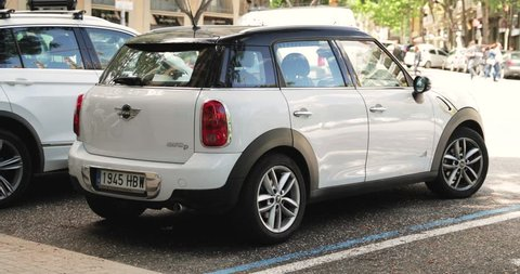 White Color Mini Cooper All 4 Car Parking In Street.