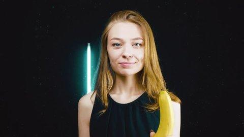 A vegetarian girl peeling a banana and eats it.