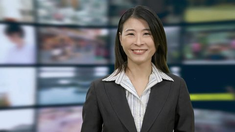 Chinese Asian American news anchorwoman in studio