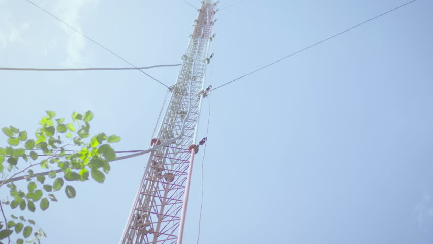 Telecommunication GSM (5G,4G) tower.The cellular phone antennas in rural areas.Telecom network base station.Telecommunication mast television post.Development communication.4k   Shutterstock HD Video #1011745262