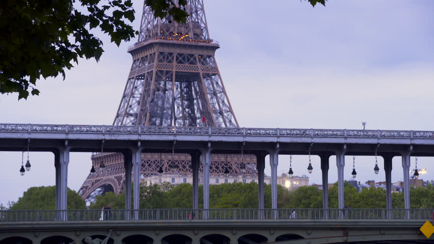France, Paris, May, 02-2018- Aerial subway on Bir Hakeim bridge with eiffel tower in background | Shutterstock HD Video #1011752072