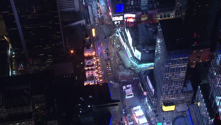 Top down view aerial night time establishing shot straight down of busy traffic on New York City manhattan street through tall buildings into Times Square. NX HD stock video | Shutterstock HD Video #1011756902