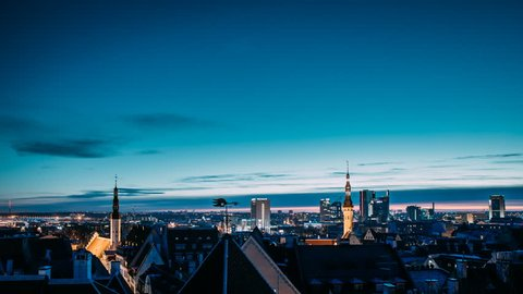 Tallinn, Estonia, Europe. Time Lapse Time-lapse Night To Day, Of Cityscape. Transition From Night To Morning Sunrise. Old Town And Modern City. Popular Place With Famous Landmarks. UNESCO.