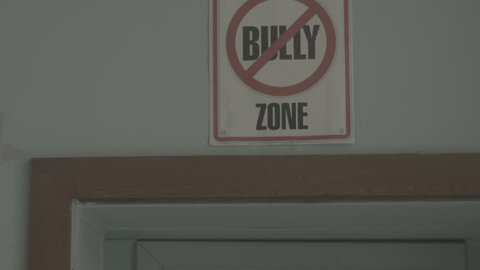 """""""No bully zone"""" school sign on wall"""