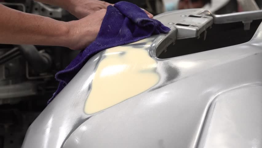 4K Garage Car body work car auto car repair car paint after the accident during the spraying automotive.