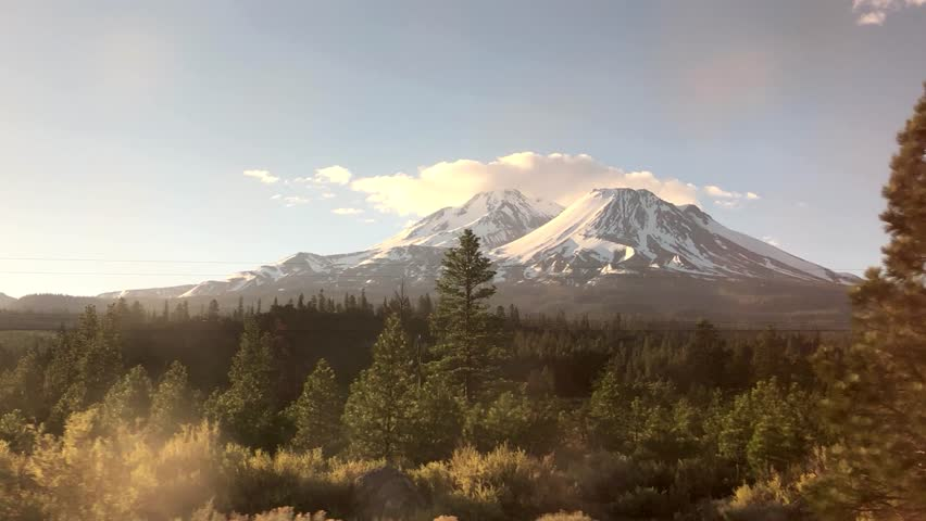 The view of Mount Shasta in California, USA, as seen from the Amtrak Coast Starlight train.