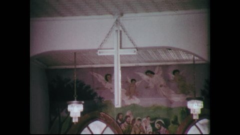 1960s: View of cross. Painting of last supper. Close ups of women. Close up of baby. Cars driving on highway at night, shot goes out of focus.