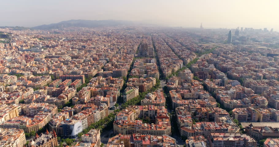 Aerial view of Barcelona city skyline with morning light, Spain. Cityscape with typical urban octagon blocks | Shutterstock HD Video #1011846122