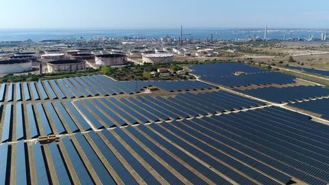 Aerial bird view footage of solar park also known as photovoltaic power station this is large-scale photovoltaic system designed for the supply of merchant power into the electricity grid 4k quality