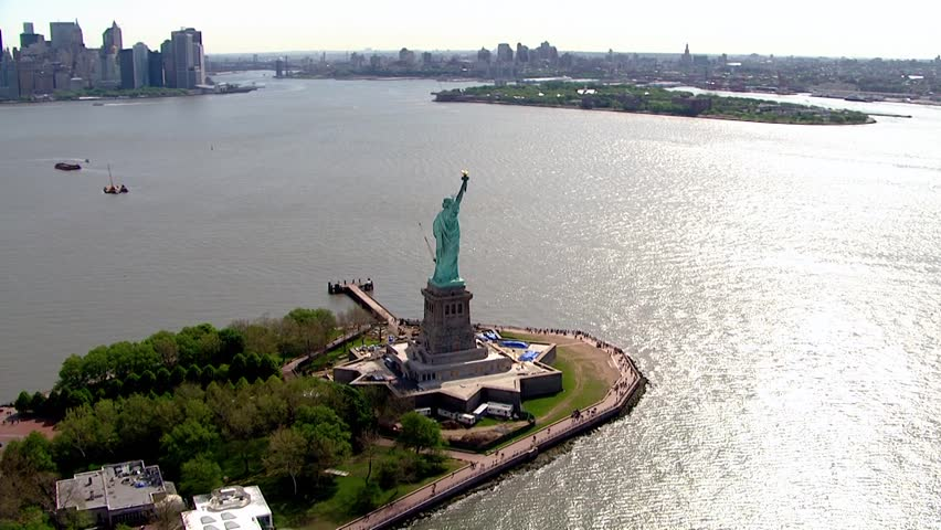 Aerial flyby close up of statue of liberty on a clear summer day mark symbol of freedom and independence in America