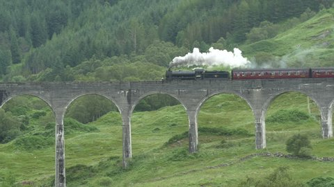 Glasgow, United Kingdom - May, 2016: The Jacobite Steam Train rolling on the Glenfinnan Viaduct