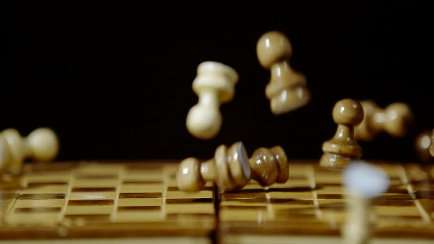 Close up of chess pieces falling on chess board, Ultra Slow Motion
