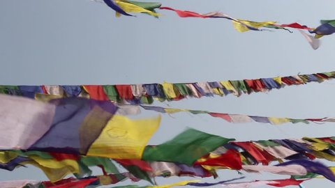 Prayer flags flying from Boudhanath Stupa, Buddhist Temple naer Kathmandu, Nepal