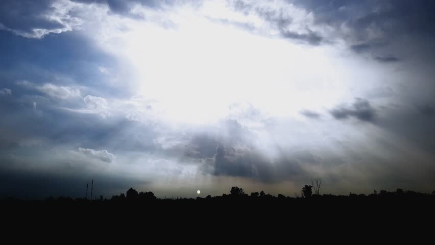 Beautiful silhouette sun rays through the clouds time lapse | Shutterstock HD Video #1011964052