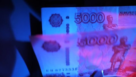 Banknotes counter works with 5000 rubles RUB macro shot