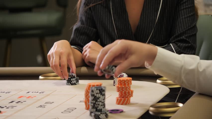 Chips in the hands of a woman  Girl playing poker Women's hands holding chips | Shutterstock HD Video #1012027622