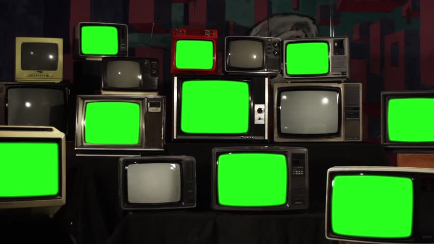 Many Tvs With Green Screens. Aesthetics of the 80s. Zoom Out. Ready to Replace Green Screens with Any Footage or Picture you Want.  | Shutterstock HD Video #1012058822