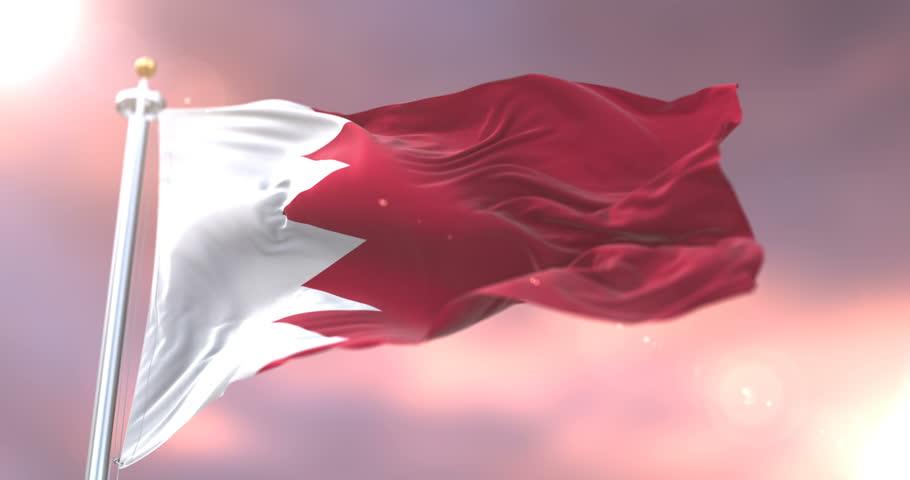 Bahrain flag waving at wind in slow at sunset, loop
