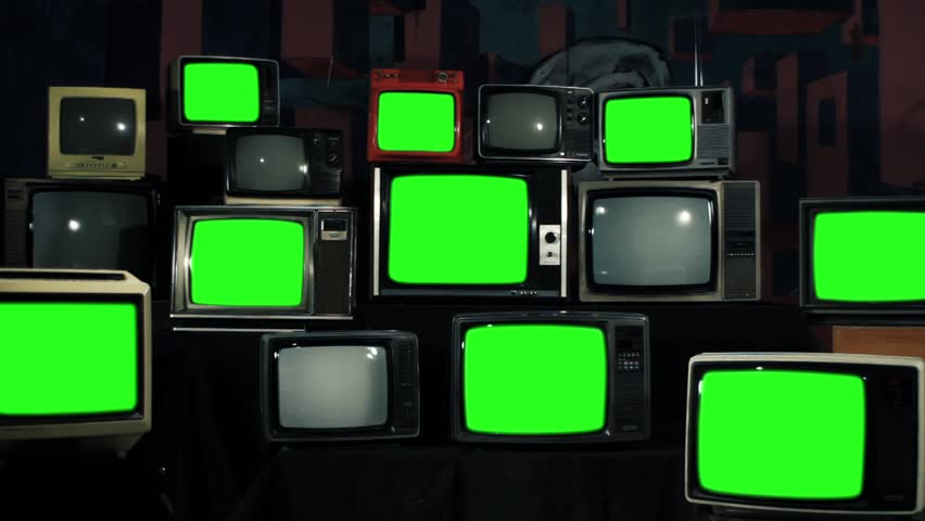 Many Tvs with Green Screens Turning On. Iron Tone. Zoom Out. Aesthetics of the 80s. Ready to Replace Green Screens with Any Footage or Picture you Want.  | Shutterstock HD Video #1012061852