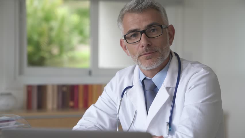 Doctor with eyeglasses talking to camera
