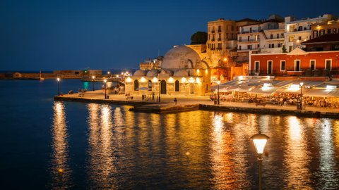 Night timelapse view of the Old Town promenade in Chania, Crete, Greece featuring the famous Mosque of the Janissaries
